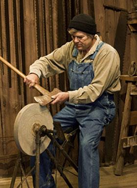 Guy grinding an ax